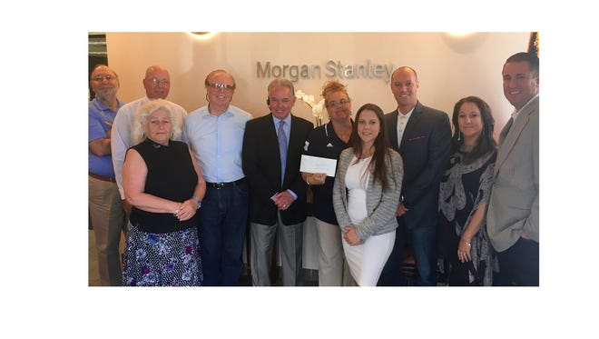 """Morgan Stanley Wealth Management's Vineland Branch presented a check for $155 to New Jersey Special Olympics Area 8, which includes Atlantic, Cape May and Cumberland counties on Sept. 16. The check represented proceeds of the branch's """"Casual Charity Fridays"""" program. (From left) Rich Catrambone, financial adviser; Jack Whiteway, financial adviser; Maria Grant, sales assistant; Wayne Campbell, financial adviser; Rob McAllister, financial adviser; Linda Cobb, director, New Jersey Special Olympics; Jenna Biagi, sales assistant; Michael Ahrens, financial adviser and branch manager; Vanessa Brown, financial adviser; and John Fitzgerald, financial adviser; from Morgan Stanley Wealth Management's Vineland Branch are pictured. Al Lupcho, financial adviser; Steven Caltabiano, financial adviser; Charles Allen, financial adviser; and Rob McAllister Jr., sales assistant, who also supported the program are not pictured."""