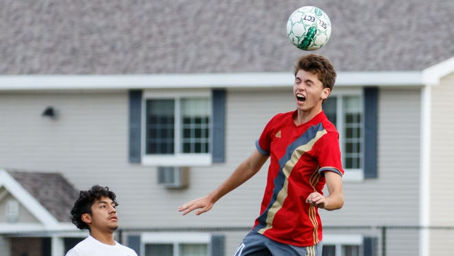 Pewaukee junior Jack Marks elevates for a header during the match at Greenfield on Monday, Oct. 2.