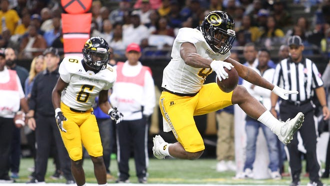 Grambling State Tigers' Martez Carter (4) leaps into the end zone with an 11-yard touchdown during the 43rd Bayou Classic between the Southern University Jaguars and the Grambling State Tigers at the Superdome on Saturday.