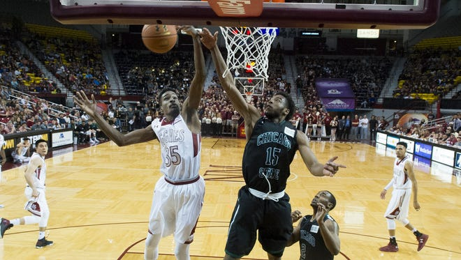 New Mexico State's Jayln Pennie, left, fights for the rebound with Chicago State's Trayvon Palmer during second half action Saturday night at the Pan American Center.