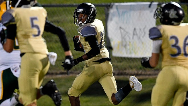 Mt. Juliet's Jeramiah Birdsong (22) scores a touchdown on an interception against Gallatin during the first half Sept. 8, 2017.