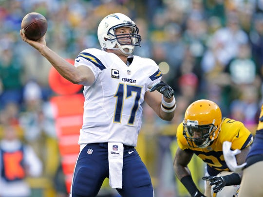 San Diego Chargers quarterback Philip Rivers (17) throws under pressure from Green Bay Packers free safety Ha Ha Clinton-Dix (21) at Lambeau Field October 18, 2015.