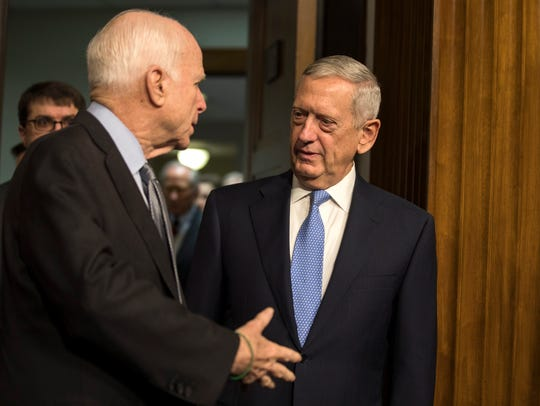 James Mattis speaks with Sen. John McCain before his