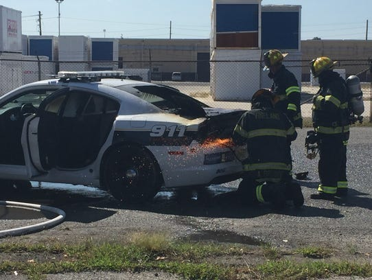 Vineland firefighters cut open the trunk of police