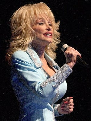 Dolly Parton performs in Sioux Falls in 2002.