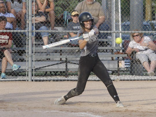 Ankeny Centennial's Taylor Runchey hits a single during