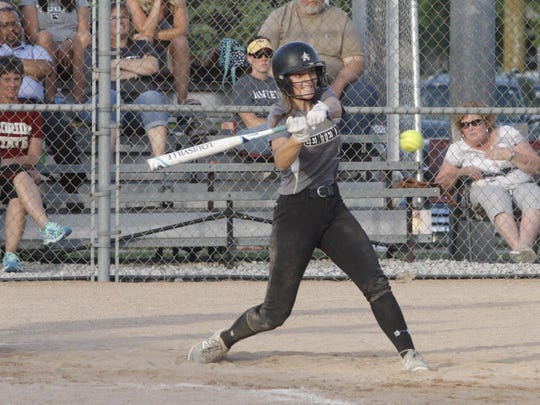 Ankeny Centennial's Taylor Runchey hits a single during the first game of Wednesday's doubleheader against visiting Ankeny. Runchey went 4-for-4 and drove in a run to help the Jaguars to a 5-3 victory in the opener.