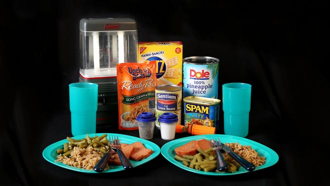 Dinner for two made from items in an emergency-preparedness kit, including Spam, wild rice, green beans, crackers and pineapple juice. Photographed on Friday, Oct. 21, 2016.