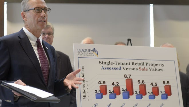 """Curt Witynski, assistant director of the League of Wisconsin Municipalities, talks at a press conference Monday, Dec. 11, 2017, at Ashwaubenon Community Center to demand that state lawmakers close the so-called """"dark stores"""" loophole.  Northeast Wisconsin local-government representatives say the loophole shifts property tax burden from big-box retailers to homeowners and small businesses."""