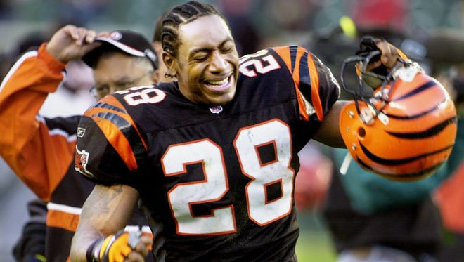 Bengals' running back Corey Dillon reacts to fumbling the ball deep in Bengal's territory during overtime against Tampa Bay at Paul Brown Stadium, December 2, 2001. The fumble resulted in a field goal and a loss for the Bengals, 16-13.