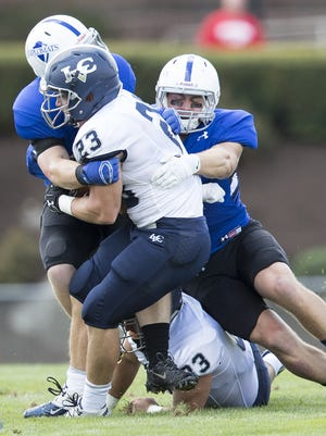LVC running back Ryan Fink is stacked up by the F&M defense, which held the Dutchmen to just 78 rushing yards on Saturday.