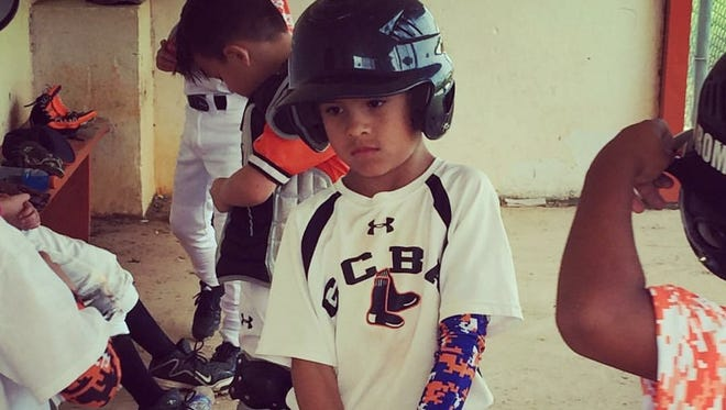 Jayden Salazar, 8, has put baseball on hold as he undergoes chemotherapy treatments for non-Hodgkin lymphoma cancer. His teammates are rallying around him and playing in a tournament in his honor this weekend.