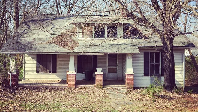 Before: Built in 1920, the Craftsman home at 7705 Brickyard Road was purchased by the Scott family from the Cruze family in 1952. The house had sat vacant for 20 years, without water or power for 15 years and had slowly deteriorated.