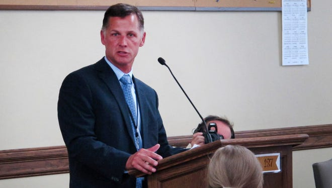 Blue Cross and Blue Shield of Montana president Mike Frank explains his company's proposal to raise insurance rates 23 percent for individuals covered under the Affordable Care Act on Wednesday,