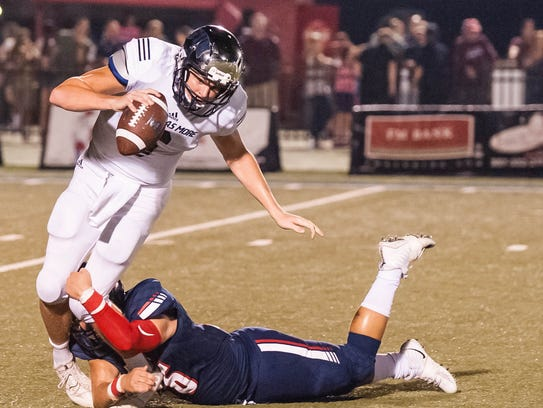 St. Thomas More quarterback Caleb Holstein is tackled in an Oct. 13 game against Teurlings Catholic. Buddy Delahoussaye/Special to the Advertiser