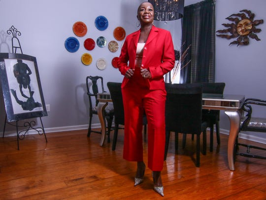 Pattie Brumskill wears a custom-made single-breasted red pants suit with ankle-length pants, camisole from Banana Republic; faux snakeskin pumps by Michael Antonio.