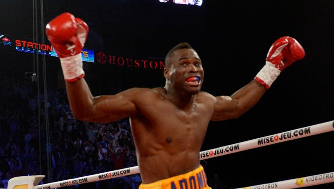 Adonis Stevenson, shown after defeating Chad Dawson in 2013, will fight on the first CBS card on April 4. (gold/yellow) celebrates after knocking out Chad Dawson (not pictured) during the first round of their light heavyweight  WBC title bout at the Bell Centre. Mandatory Credit: Eric Bolte-USA TODAY Sports usp ORG XMIT: USATSI-133488 [Via MerlinFTP Drop]