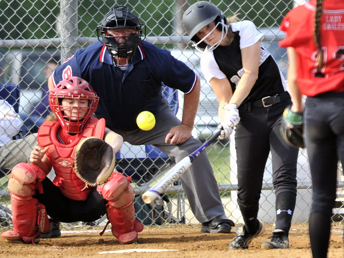 Taylor Wroten of Sussex Tech drives a pitch toward second base but was thrown out late in the game with Smyrna on Thursday.