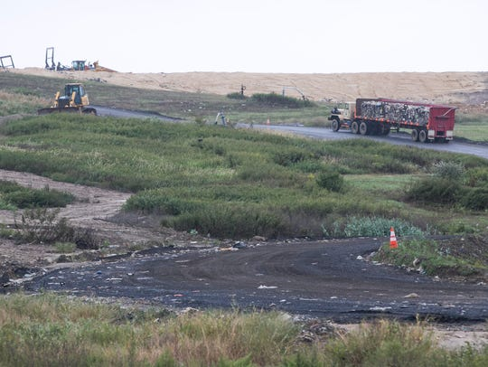 Compacted garbage is trucked to the landfill site at