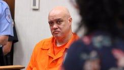 Former Neptune Police Sergeant Philip Seidle listens