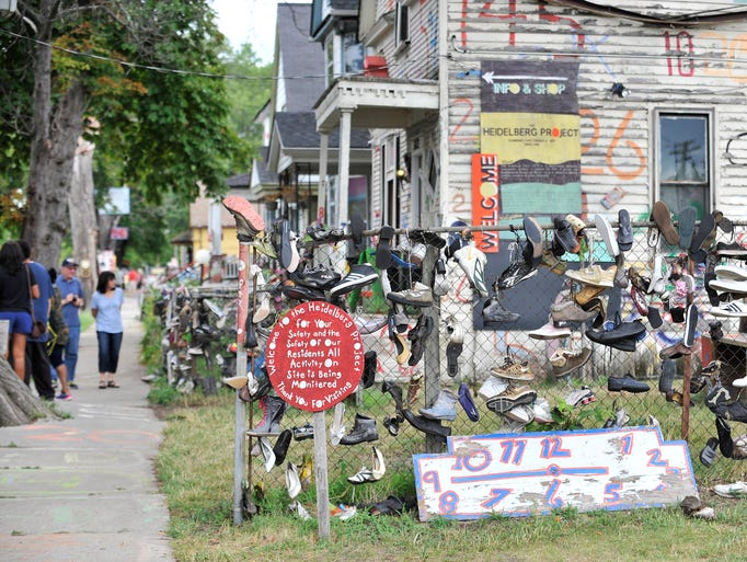 Visitors check out the Heidelberg Project in Detroit