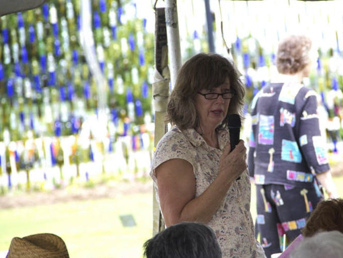 "Carol Reese speaks in front of a corwd at the UT Institute of Agriculture's Summer Celebration Lawn and Garden show Thursday in Jackson. ""Got Something To Hide?"" was the title of her talk."