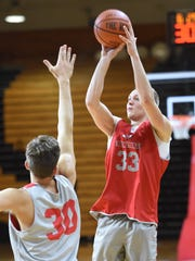 Marist College's David Knudsen, right, takes a shot as Ryan Funk attempts to defend during Tuesday's practice at Marist College.