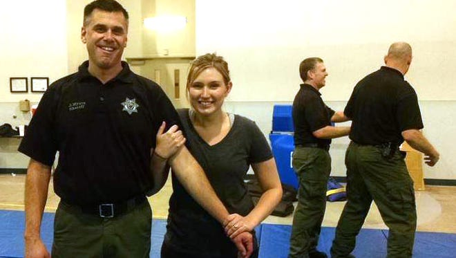 Marion Co. Sheriff Jason Myers and Statesman Journal reporter Alexa Armstrong.