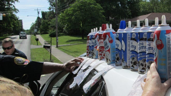 These nearly empty whipped creams were found in a Franklin woman's SUV.
