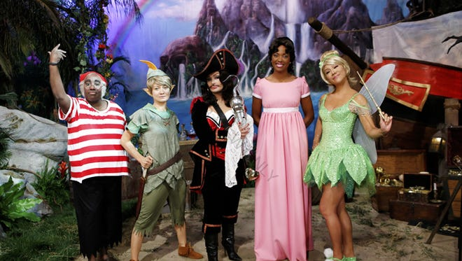 From left: Sheryl Underwood is Mr. Smee, Sara Gilbert is Peter Pan, Sharon Osbourne is Captain Hook, Aisha Tyler is Wendy and Julie Chen is Tinker Bell on a special Halloween episode of 'The Talk' airing Oct. 31, 2013.