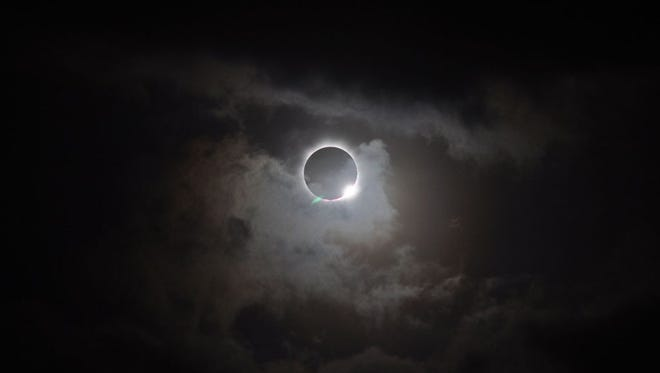 A total eclipse is shown in the southern hemisphere from a NASA file photo.