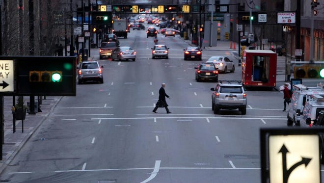 A man crosses Vine Street Monday on another cold morning.