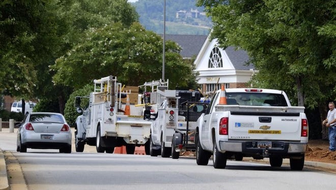 Crews from Piedmont Natural Gas survey the scene near Timmons Arena.