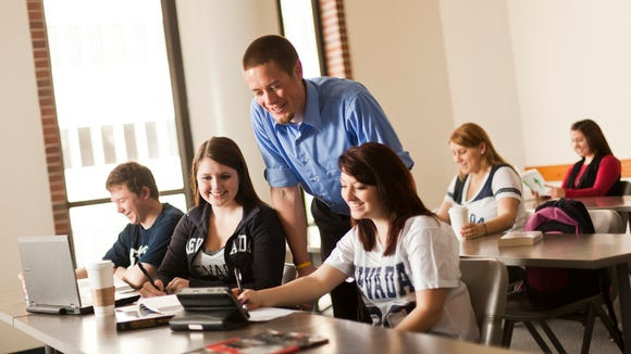 Daniel Herr of NIREC poses with students at UNR's College of Business.