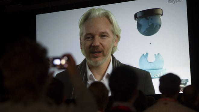 Julian Assange, founder of WikiLeaks, speaks on screen at the South By Southwest festival in Austin in March.