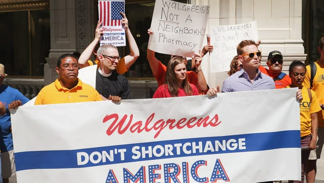 Demonstrators protest the possibility of Walgreens moving their corporate headquarters overseas outside a Walgreens store on July 24 in Chicago.