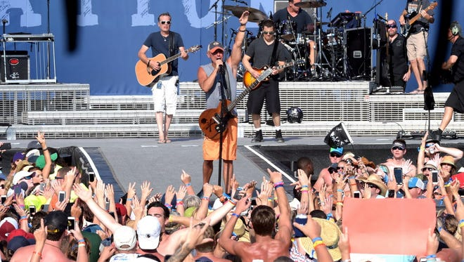 Kenny Chesney peforms live at Kenny Chesney's Flora-Bama-Jama, a free beachplay for 40,000 on the Florida/Alabama line, behind the historic Flora-Bama on Aug. 16, 2014, in Orange Beach, Ala.