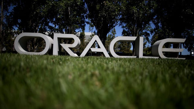 REDWOOD SHORES, CA - JUNE 19:  The Oracle logo is displayed in front of the Oracle headquarters on June 19, 2014 in Redwood Shores, California.  Oracle will report fourth quarter earnings today after the closing bell.  (Photo by Justin Sullivan/Getty Images) ORG XMIT: 498662085 ORIG FILE ID: 450874642