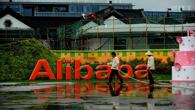 Workers clean the grounds of the Alibaba head office in Hangzhou, east China's Zhejiang province on September 15, 2014.  Alibaba founder Jack Ma struck a conciliatory note over its failure to list in Hong Kong, as the Chinese e-commerce giant began an Asian roadshow before a possible record-breaking IPO in New York.     CHINA OUT      AFP PHOTOSTR/AFP/Getty Images ORIG FILE ID: 533430988