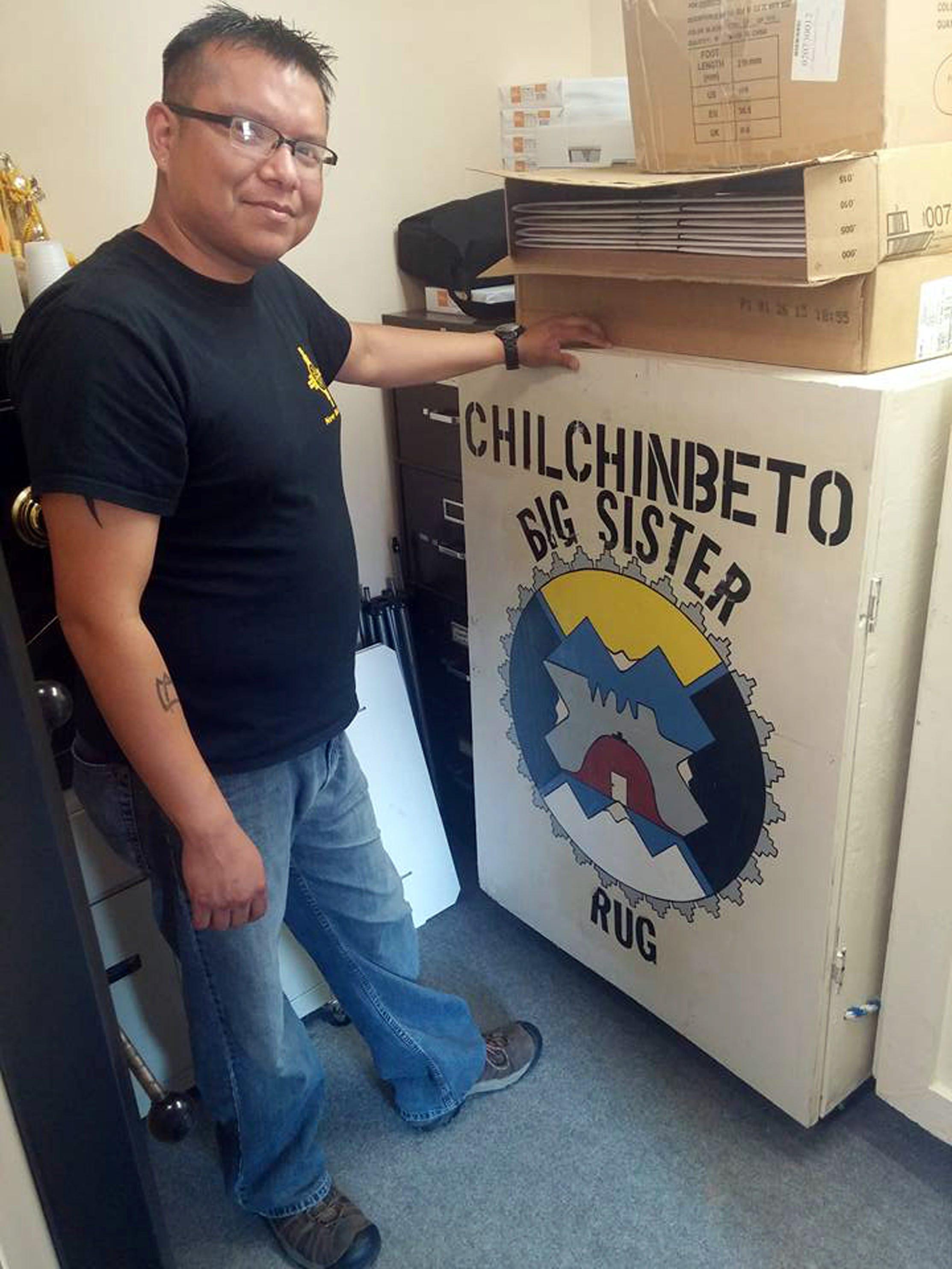 Filmmaker Dwayne Joe Poses With The Box Where The Big