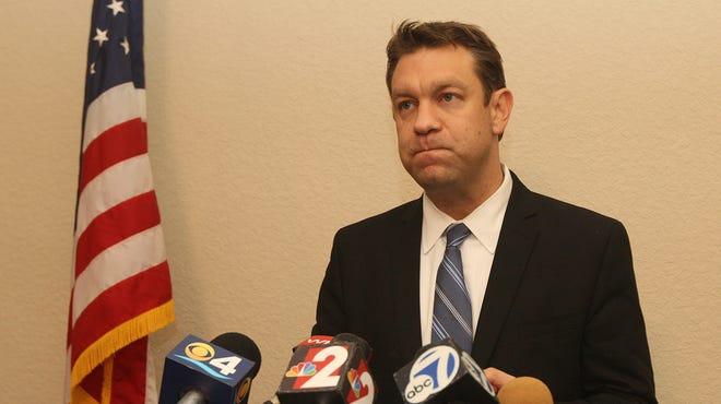 Congressman Trey Radel addresses the news media after pleading guilty to cocaine possession Nov. 20.