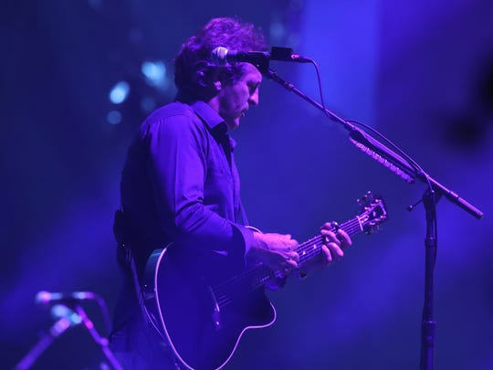 Guitarist Tommy Byrnes plays during the Billy Joel