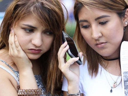 (L to R) Paola Soria and Karla Collaguazo, both 20