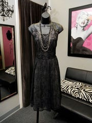 A black dress with lace overlay and a black and silver dress embellished with sequins both at The Curvy Closet, 114 N. Willis St., Visalia.