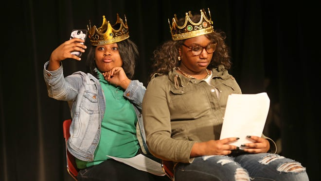 Celina Desinore, left, takes a quick selfie with her phone as she and Shakeyra Beaman, both of Rochester, rehearse a scene from William Shakespeare's Henry V during the Shakespeare from the Streets project rehearsal at SWAN Community Center in Rochester Tuesday, Feb. 23, 2016.  Beaman is playing the part of Henry V and Desinore is playing the Dauphin.