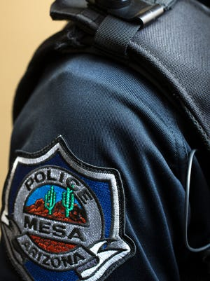 Mesa Police Department patch and body camera.