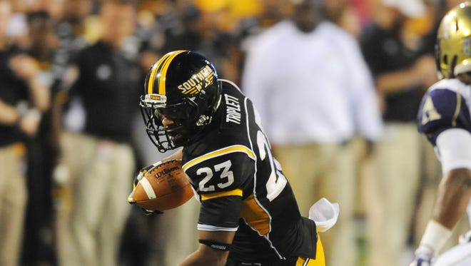 Southern Miss' Markese Triplett (23) attempts to get past Alcorn State's Hendrick Taylor (30) during their game at M.M. Roberts Stadium.