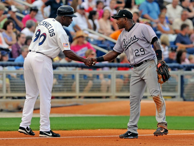 Blue Wahoos manager Delino DeShields greets Miguel Tejada between innings Saturday as the Blue Wahoos took on the Jacksonville Suns at Pensacola Bayfront Stadium.