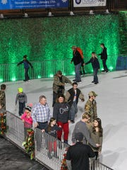 Skaters move around the ice-skating rink Thursday at