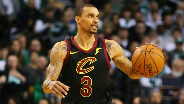 George Hill of the Cleveland Cavaliers dribbles during